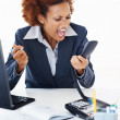 Woman screaming into phone receiver - Stock Photo
