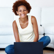 Woman sitting with laptop - Lizenzfreies Foto