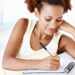 Woman making to do list - Stockfoto