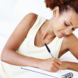 Woman writing her agenda - Stock Photo