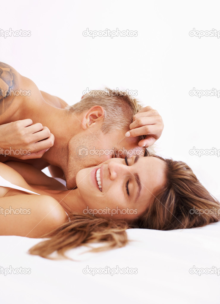 Portrait of young couple making love while lying in bed — Stock Photo #7875246