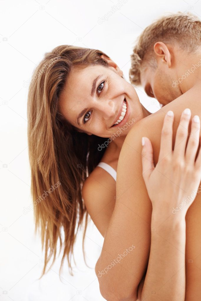 Portrait of cheerful woman with man enjoying together in bed — Stock Photo #7875318