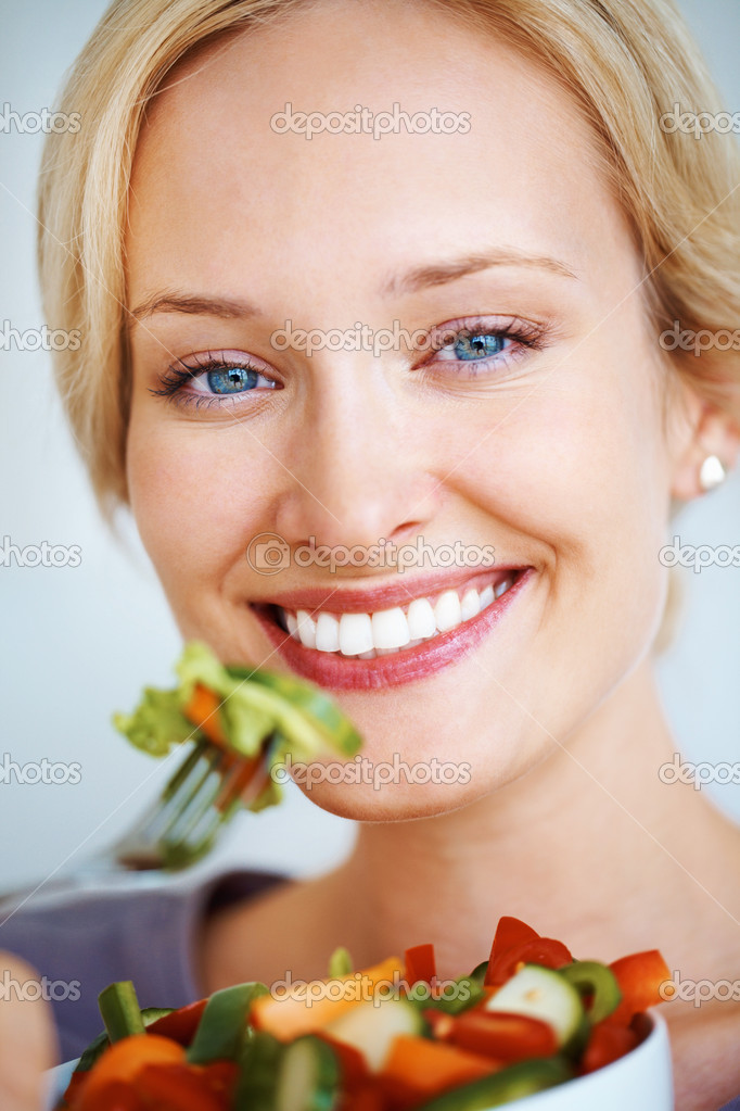 Closeup of young woman eating healthy food — Stock Photo #7876135