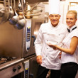 Chef directing trainee - Stock Photo