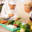 Royalty-Free Stock Photo: Chef giving cooking lessons to trainee