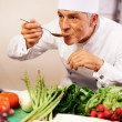 Royalty-Free Stock Photo: Cook tasting his self prepared food