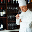 Royalty-Free Stock Photo: Handsome cook tasting red wine