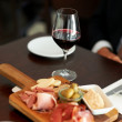 Delicious cheese and meat platter with wine - Zdjęcie stockowe