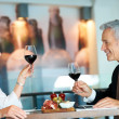 Royalty-Free Stock Photo: Mature couple having romantic dinner in a restaurant