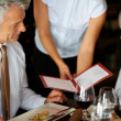 Royalty-Free Stock Photo: Mature couple having a dinner at restaurant