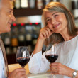 Royalty-Free Stock Photo: Mature couple at bar with wine glasses