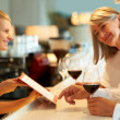 Royalty-Free Stock Photo: Mature couple ordering wine at the bar
