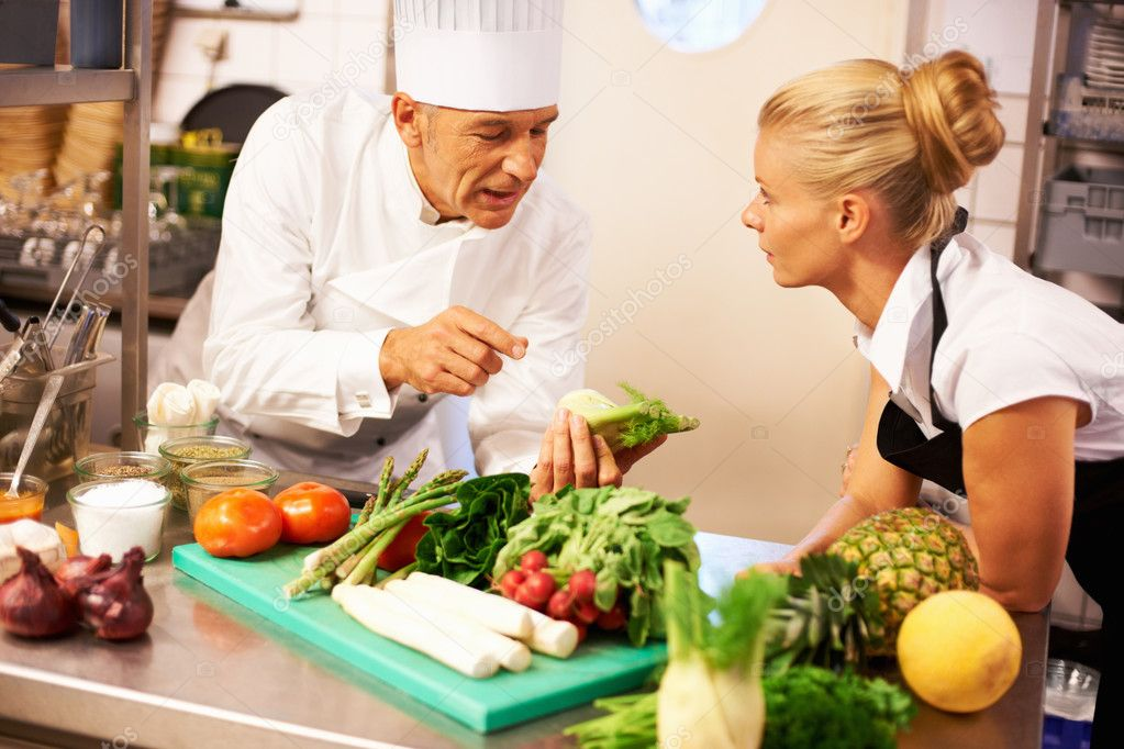 Portrait of male chef giving culinary lessons to trainee in kitchen  Stock Photo #7880872
