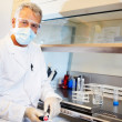 Royalty-Free Stock Photo: Male scientist conducting an experiment