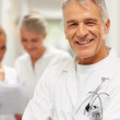 Royalty-Free Stock Photo: Sucessful physician with two nurses in background