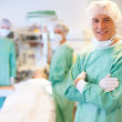 Confident male surgeon in operation theater - Stock Photo