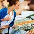 Royalty-Free Stock Photo: Beautiful woman selecting seafood