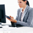 Business woman with calculator - Stock Photo