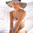 Smiling woman in sun hat - Stock Photo