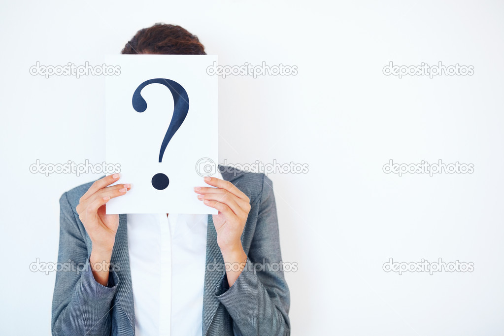 Portrait of confused business woman holding question mark sheet over white background  Stock Photo #7898078
