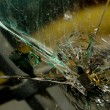 Broken glass with bullet hole — Stock Photo