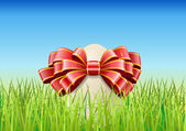 Easter egg is on the grass. — Stock Vector