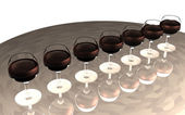 Seven red wine glasses — 图库照片
