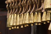 Old brass village bells hanging on a row — Stock Photo
