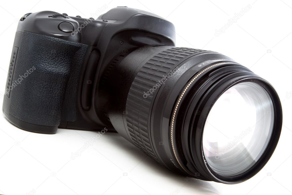 Reflex black camera with a deliberate glow in growing from the lens — Stock Photo #6829411