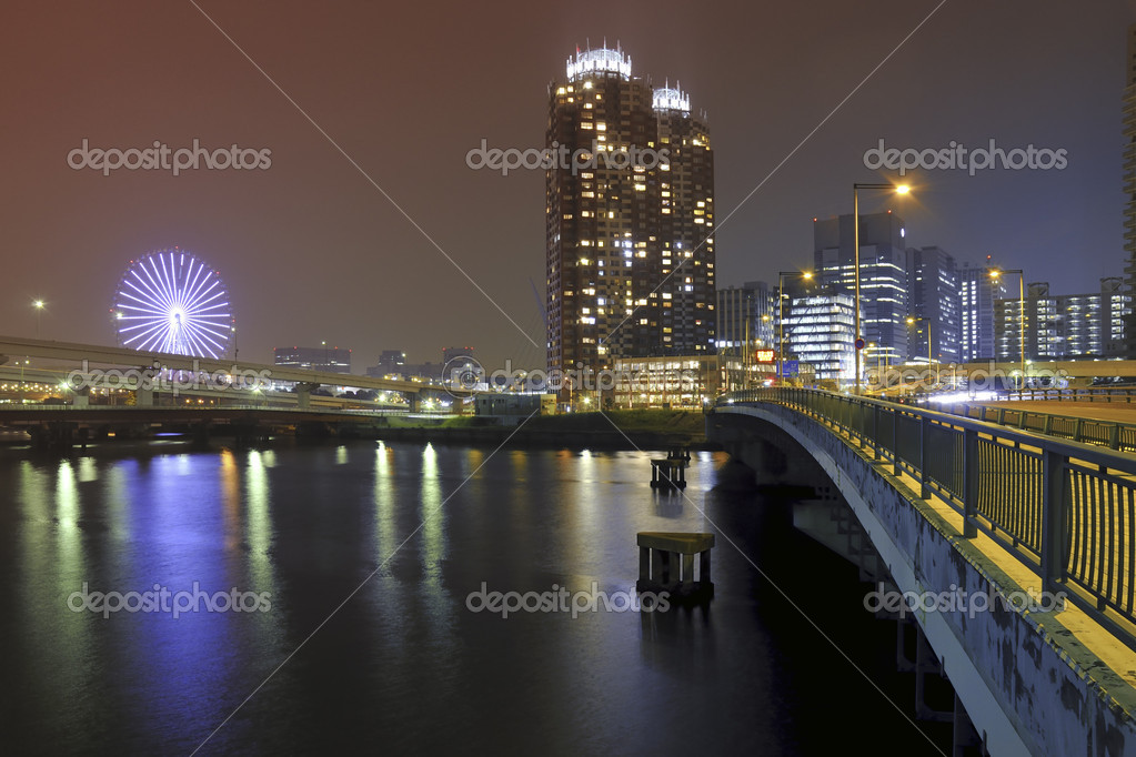Modern city well illuminated by night with scenic water reflection  Stock Photo #7184939