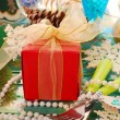 Table decoration with gift for christmas — Stock Photo