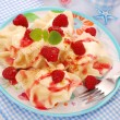 Ravioli (pierogi) with cottage cheese and raspberry — Stok fotoğraf