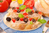 Crostini with pate and olives — Stock Photo