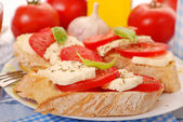 Crostini with caprese — Stock Photo