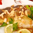 Carp baked with almonds on christmas table — Stock Photo