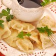 Pierogi (ravioli) and barszcz (borscht) for christmas - Stock Photo