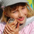 Young girl with hamster outdoor — Stock Photo
