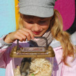 Young girl  with hamster in portable transporter - Stock Photo