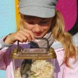 Stock Photo: Young girl with hamster in portable transporter