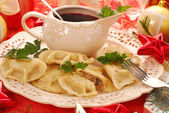 Pierogi (ravioli) and barszcz (borscht) for christmas — Stock Photo