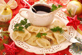 Pierogi (ravioli) and barszcz (borscht) for christmas — Stock Photo