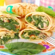 Pancakes with spinach and eggs — Stock Photo