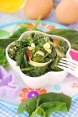 Boiled spinach with egg for baby — Stock Photo