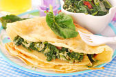 Pancakes with spinach and eggs for child — Stock Photo