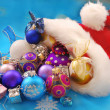 Christmas baubles in santa hat — Stock Photo #7948158