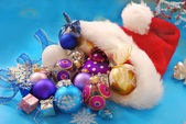 Christmas baubles in santa hat — Stock Photo