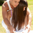 Young couple happy embrace on grass white clothes, love relationship - Stock Photo