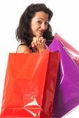 Jonge vrouw met boodschappentassen close-up geïsoleerd op witte achtergrond — Stockfoto