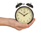 Alarm Clock in hand — Stock Photo