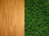 A close up image of artificle grass and timber — Stock Photo
